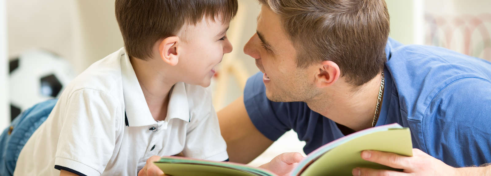 Man Helping Child Read